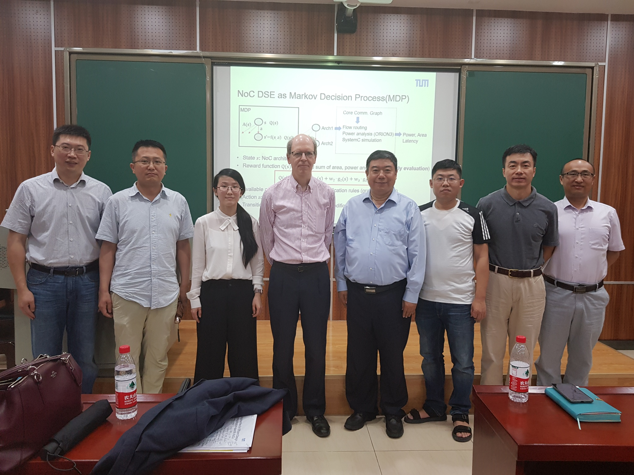 The photo shows Li Zhang and Ulf Schlichtmann together with Prof. Yintang Yang, Vice President of Xidian University, with some of his colleagues.